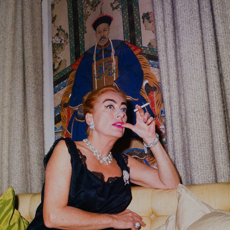 Joan by an asian tapestry in 1962.