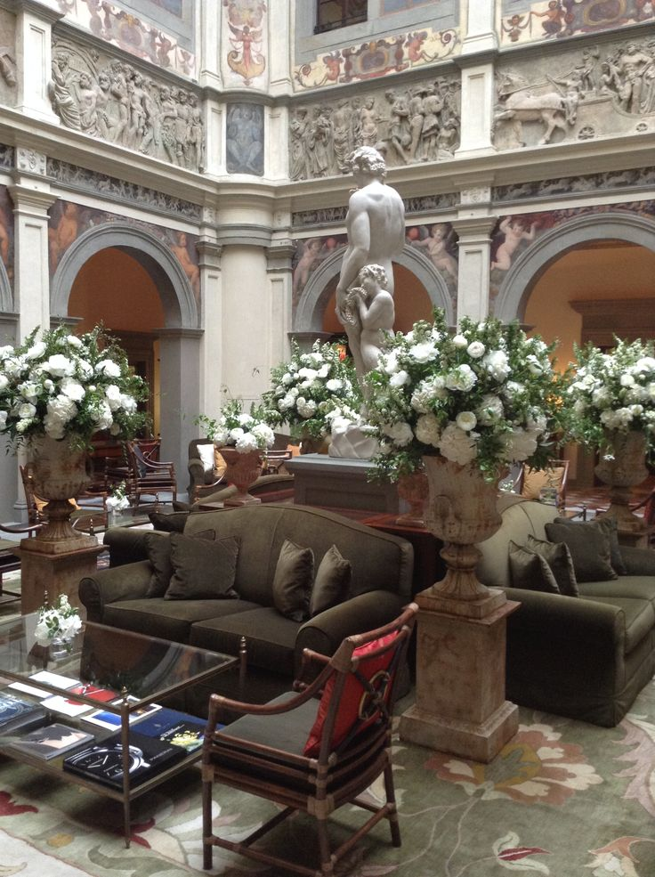 White flowers and greenery compositions in Medici vases