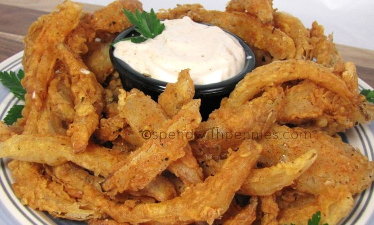Blooming Onion Bites with Dipping Sauce! Love it?  Pin it to SAVE it! Follow Spend With Pennies on Pinterest for more great recipes! This is such a fun dish to serve up as an appetizer because guests always love it! This tastes best with a big sweet...