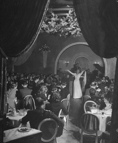 "Inga Andersen singing ""The General Doesn't Like It in the Car"" and ""Hitler's Gone and Lost His Secret Weapon"" at ""Bagatelle"" Restaurant off Berkely Street"