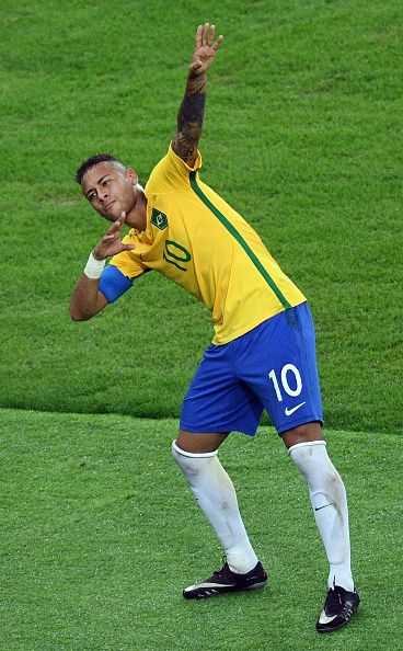 Brazil's forward Neymar celebrates scoring his team's first goal during the Rio…