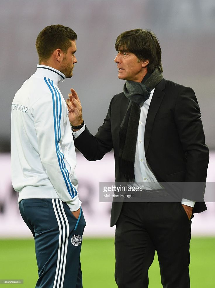 Joachim Loew head coach of Germany talks to Jonas Hector prior to the UEFA EURO 2016 Group D qualifying match between Germany and Georgia at Stadium Leipzig on October 11, 2015 in Leipzig, Germany.