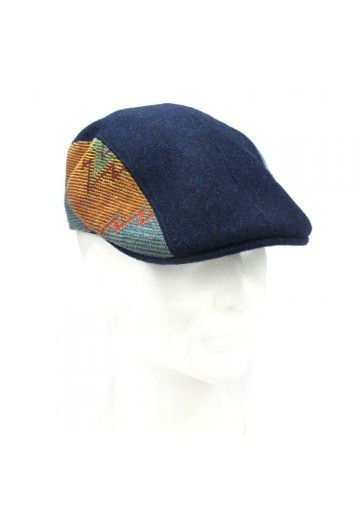 Flat cap wool ONCE  This original flat cap by Once perfectly fits men. Dark blue color and colorful side inserts characterize this headgear. It makes you unique