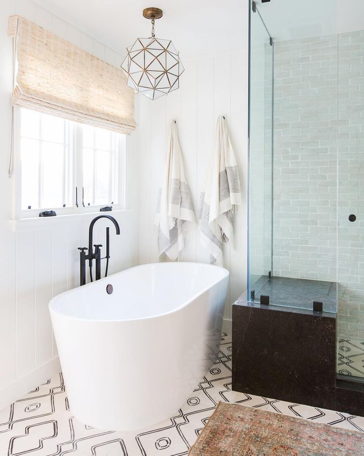 Amber Interiors | Tall Bathtub | Geometric Light Fixture | Patterned Tile - pinned by www.youngandmerri.com