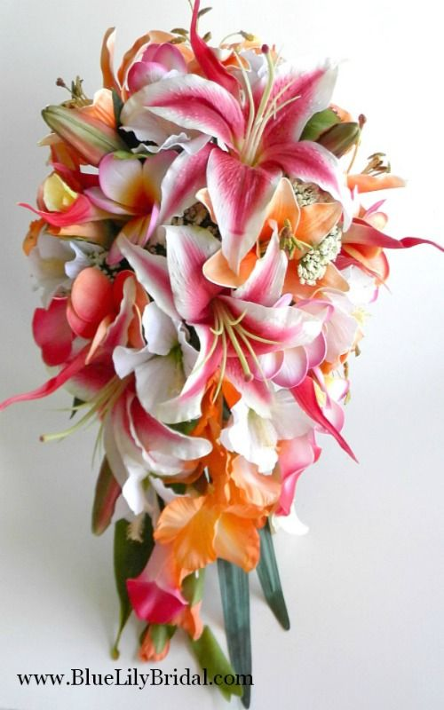 Tropical cascade bridal bouquet made up of real touch stargazer lilies, orange tiger lilies, hot pink heliconia, plumeria, gladiolus and white silk hibiscus.  www.bluelilybridal.com