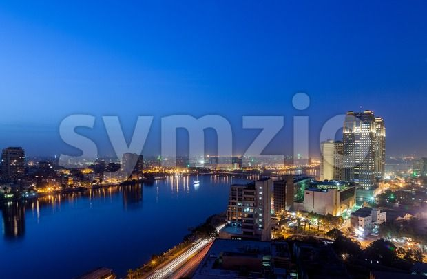 Stock photo of Fairmont Nile City Hotel in from $1.99. Night view over polluted city of cairo in egypt with...