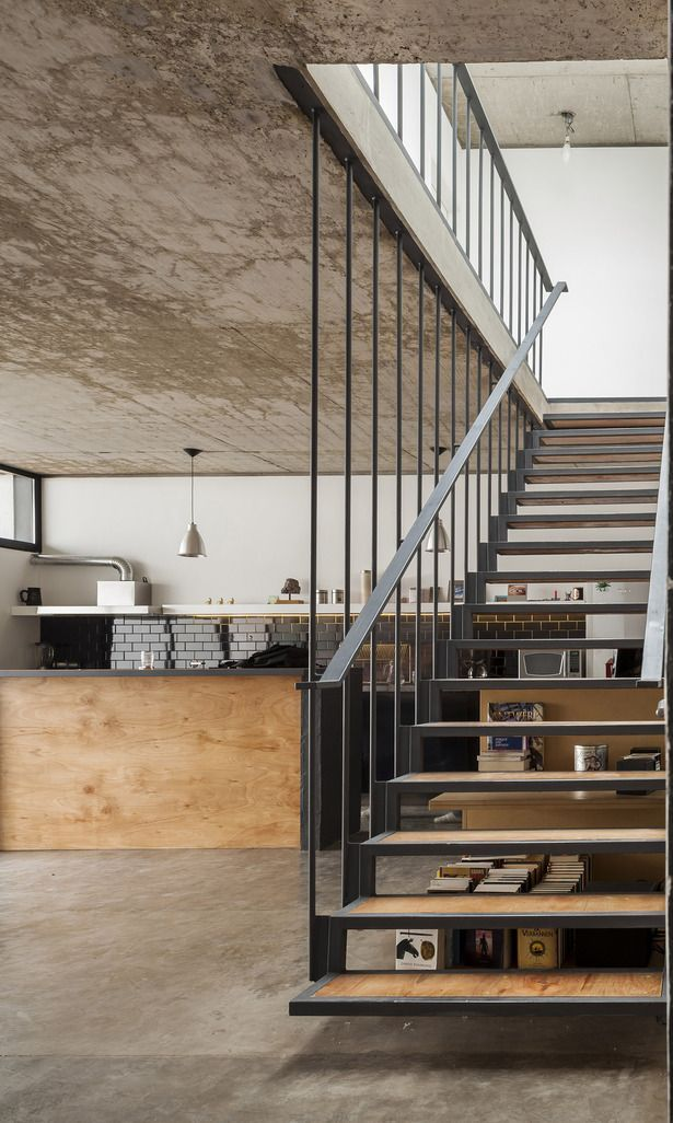 Steel suspended staircase with timber inlay and concrete floor and ceiling