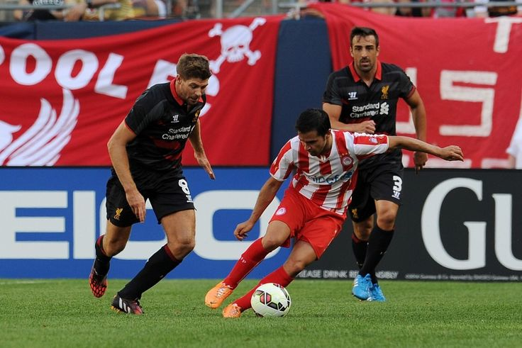 Steven Gerrard competes with Javier Saviola