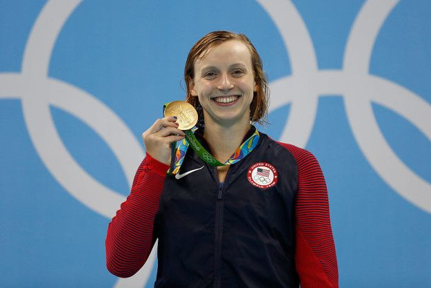Katie Ledecky *SMASHED* her own world record in the 400-meter freestyle, winning an Olympic gold medal in the process.