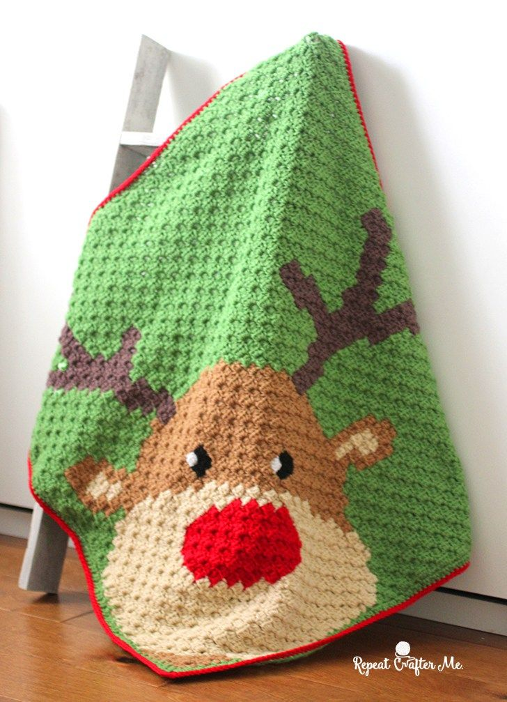 Do you recall? The most famous Reindeer of all?! Yes, it's Rudolph the Red-Nosed Reindeer peeking out of the corner of this cute C2C (corner-to-corner) blanket! I know we only have about a month until