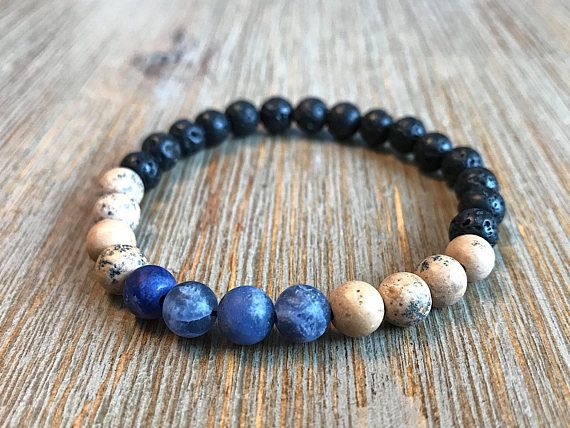 This bracelet is a combination of 6mm black lava beads, Grain stone beads with blue speckles and deep blue matte Sodalite stone beads. My inspiration behind this bracelet are the cold water streams found along the trail during long forest hikes. Lava beads are a natural and easy way to