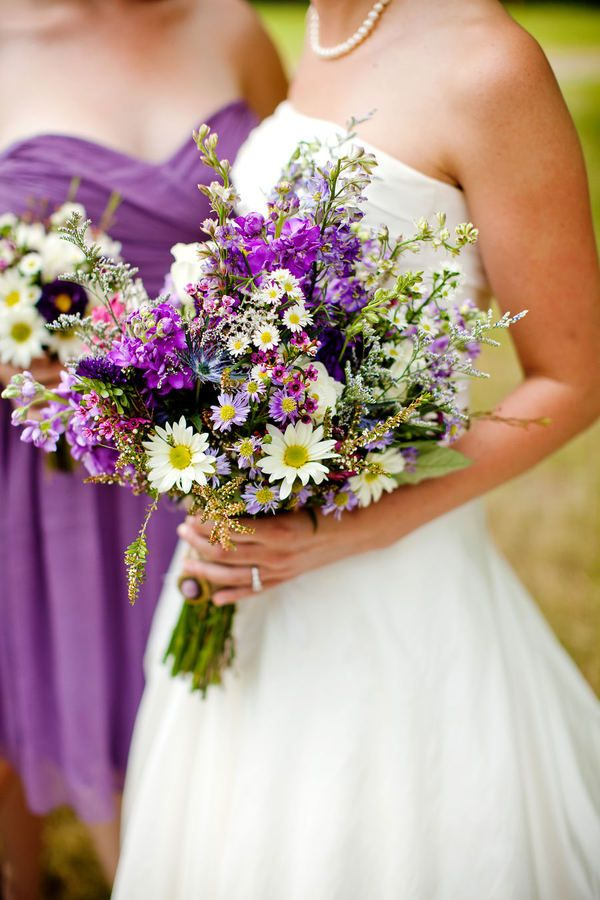 I really want to have purple in my wedding and I love the flowers the bride is holding as well as the dress the bridesmaid is wearing.
