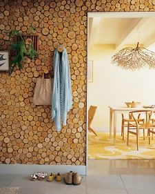 Create a graphic wall mosaic by slicing birch poles into disks and gluing them to plywood panels.