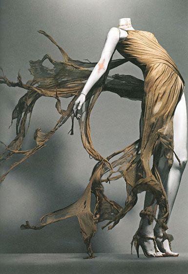 An image from the Alexander McQueen exhibit at the Met.  Inspiring! Possible for woman's dress.