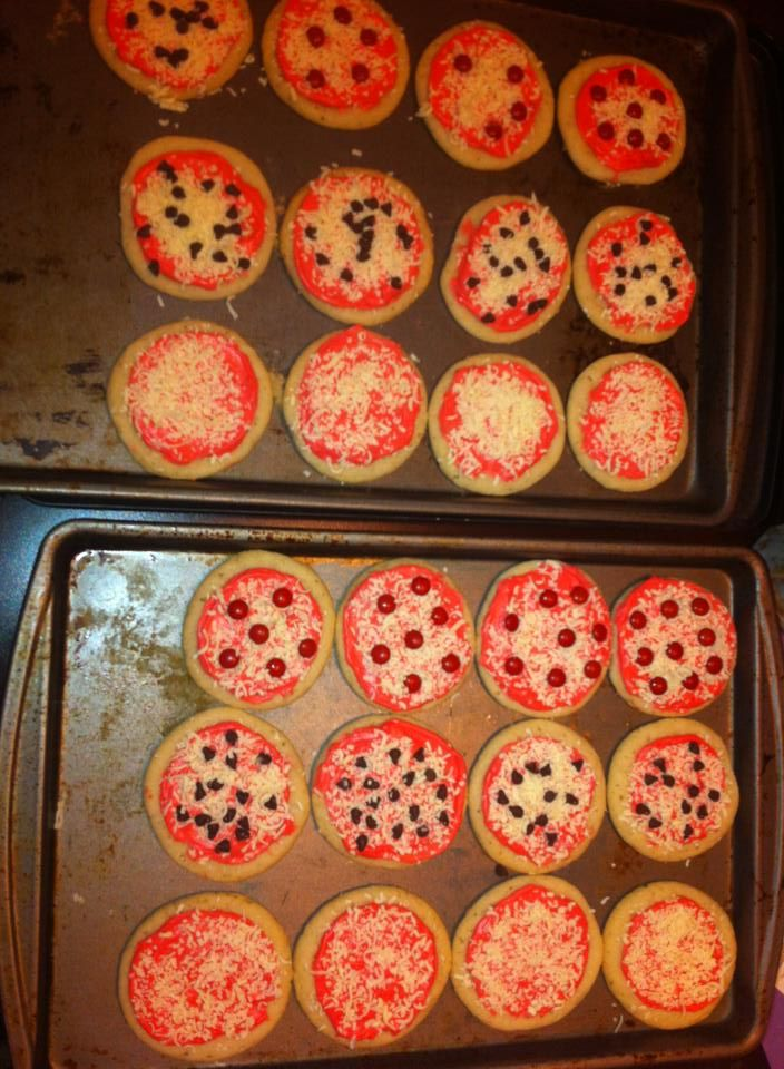 """Pizza cookies for a Ninja Turtle birthday party!  I made sugar cookies, spread the icing """"sauce"""" over the pizza cookies. Then sprinkled the """"cheese"""" (finely grated white chocolate). You can add mini chocolate chips for """"sausage"""" or red mini m&m's for """"pepperonis""""!   These were a hit!!! Everyone loved them!"""