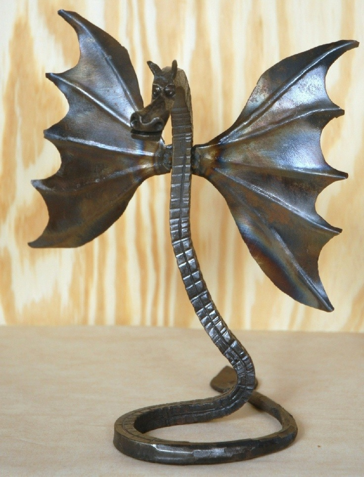 Winged Dragon sculpture Hand forged art mythical beast. $49.99, via Etsy.