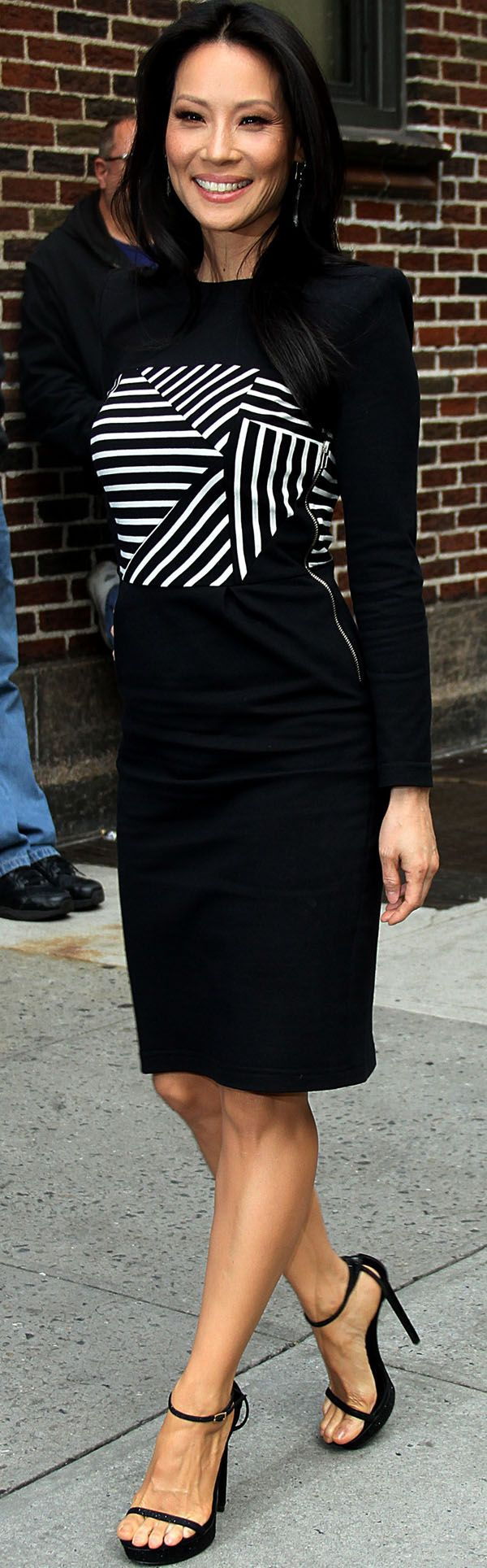 Lucy Liu in Paneled Ribbed-Knit Cotton Dress and Saint Laurent Heels