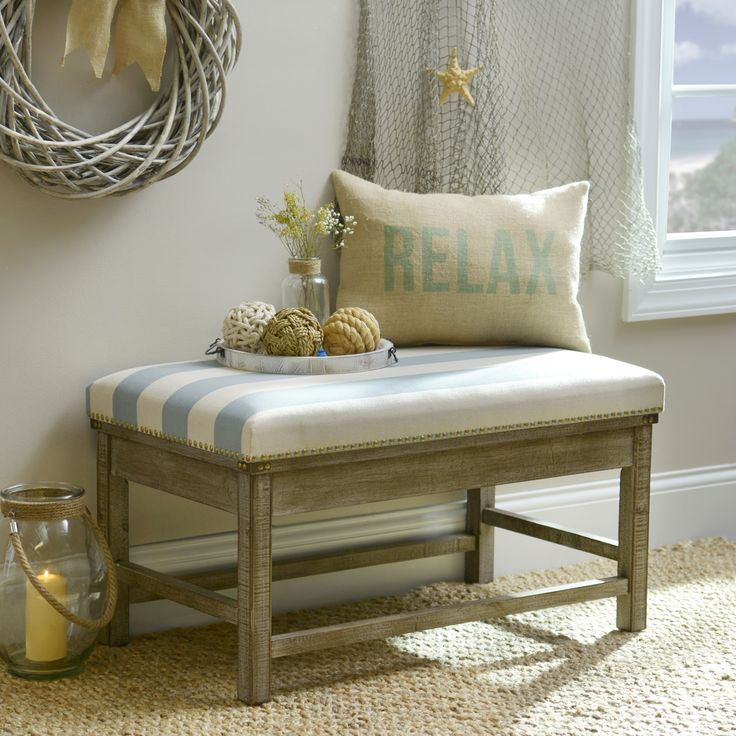 Slip away to a breezy beach with our Blue and White Striped Weathered ottoman. The wooden frame features a naturally weathered finish, and bronze nail heads accent the upholstery.