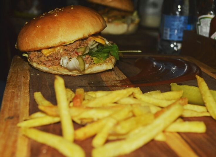 Lamb meatloaf plated with pickle and french fries at The Burger Festival in Ci Gusta, Hyderabad