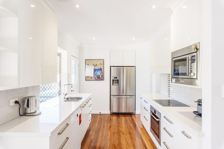 CARINA 25 Burchell Street... Capturing plenty of natural light, the tastefully updated open plan living, dining and kitchen is enhanced with polished hardwood flooring, crisp white interiors and modern downlighting.