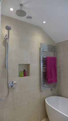contemporary small bathroom with freestanding bath, wetroom shower, chrome dual fuel towel warmer, niche and porcelain tiles over underfloor heating mat https://srijanexportstowelwarmers.co.uk/