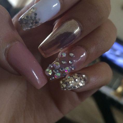 Rosegold chrome nails with glitter and Swarovski