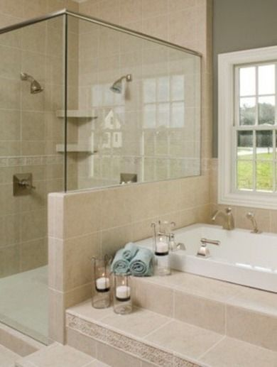 Love this Shower  A walk-in shower and built-in soaking tub are the ultimate in spa luxuries, particularly when the bathing area comes complete with double shower heads and a whirlpool bath. The half wall—separating the shower from the bathing area—opens the room up and takes advantage of natural daylight and views. A spa-like feature you might want to consider in your own bath remodel. www.abathroomguide.com