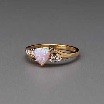 Gold Opal Ring for Lenox  Opal is my birthstone! :) looks like my promise wring <3