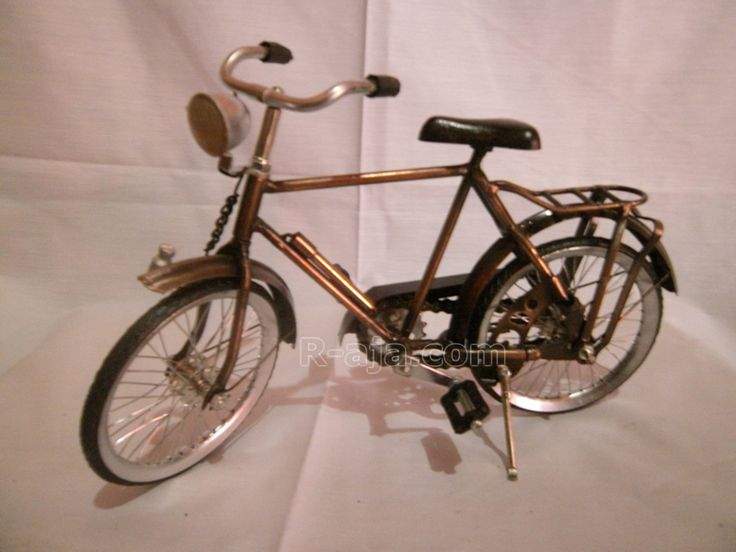 Handicraft Miniature craft bike boy made of iron copper brass.  Various size and designs classic, antique, produced by the hands of our craftsmen typical Yogyakarta – Indonesia.     Material: Iron Copper Brass  Dimension: Long: 31 cm. Height: 11 cm, Width: 19 cm.
