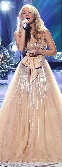 Who made Carrie Underwood's sequin bow nude long dress? Dress – Jean Fares