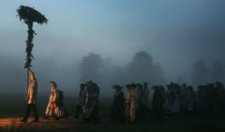Belarusian neo-pagans carry a wheel as a symbol of the sun celebrating the summer solstice in small town Rakov, some 45 kilometers (28 miles) northwest of Minsk, Belarus, Monday, June 23, 2008. The festivities of Ivan Kupala, or John the Baptist, is similar to Mardi Gras and reflects pre-Christian Slavic traditions and practices.