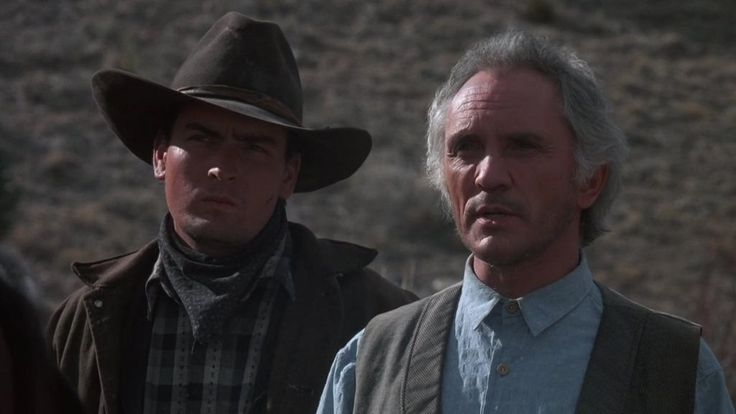 Charlie Sheen and Terence Stamp in Young Guns (1988)