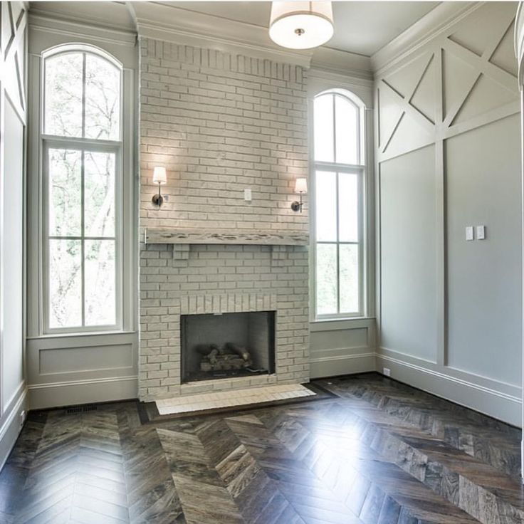 brick fireplace and herringbone flooring