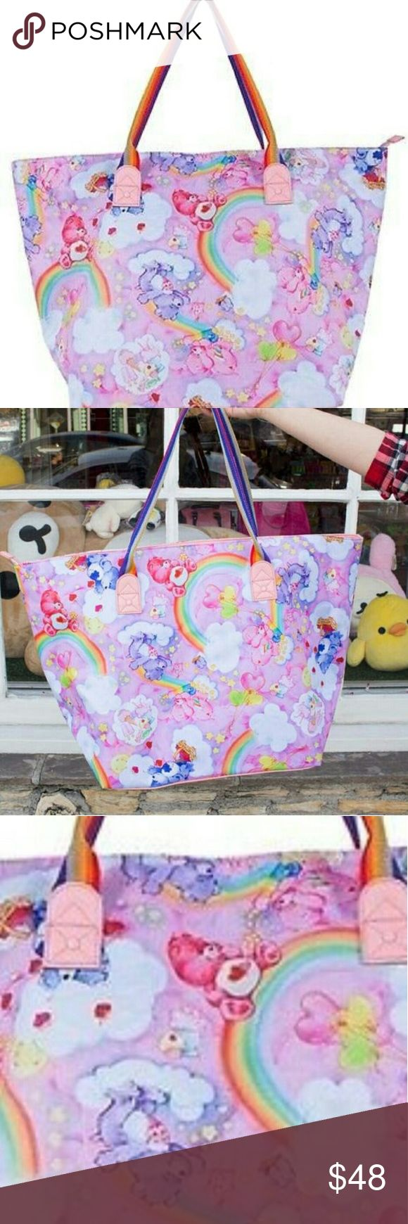 IRON FIST  Care Bears Tote Bag   Extra large Care Bears Tote Bag IRON FIST   Care Bears Tote Bag   Extra large tote bag with Care Bears print  Featuring a zipped closure and rainbow straps Iron Fist Bags
