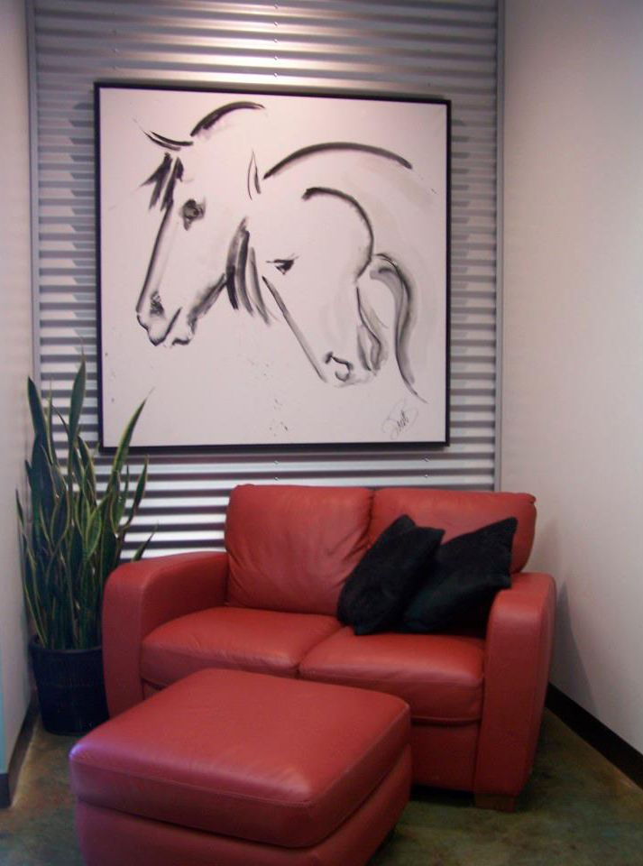 Contemporary wall art · corporate office and lobby area corrugated metal wall and bright red contemporary furniture modern