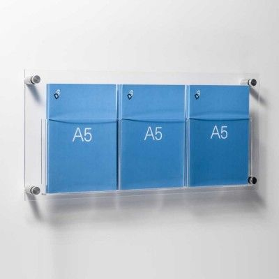 Easy to fix wall mounted acrylic leaflet holder display. This model has three A5 pockets and is 54cm wide. Supplied with wall fixings, screws and wall plugs. All you have to do is drill 4 holes.