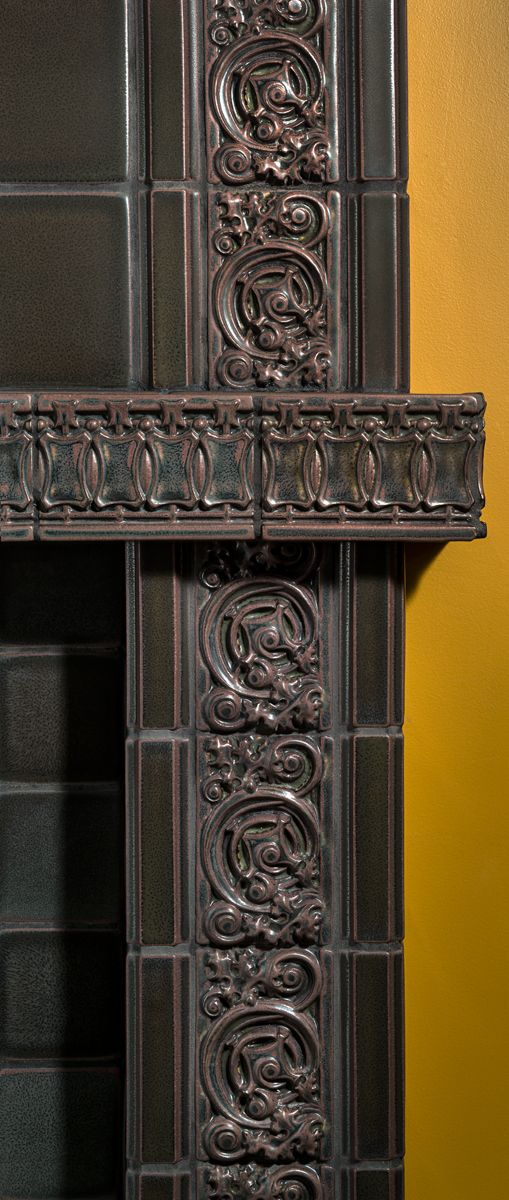 Detail of Motawi Belden & Kimball Borders featured on Halsted Fireplace seen in Granite glaze www.motawi.com