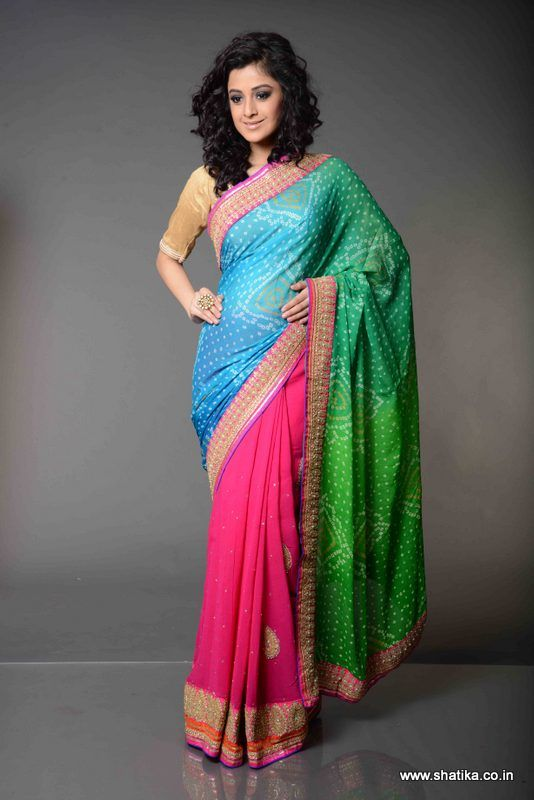 Bindiya Tri Colour Pure Bandhej Saree; Vividly striking colours, each shouting out loud and clear, Bindiya Tri Colour Bandhej Saree with beautiful chamki and kundan work on the saree body and lovely patch work border running along the entire sari, echoes the trends of modern Bandhej sarees.