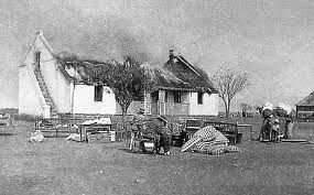 British scorched eath (burning down farmsteads to force women and children and workers into tented concentration camps). Photograph form 1901