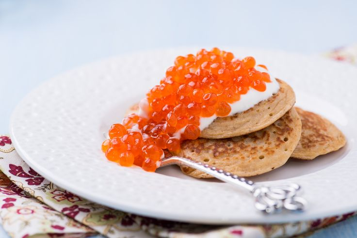 Buckwheat blini with red caviar and sour cream by Katia White on 500px