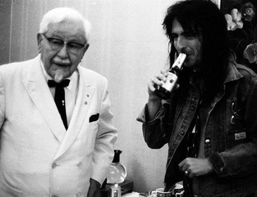 Colonel Sanders explaining to Alice Cooper, that No, even though chickens have wings, they cannot fly.