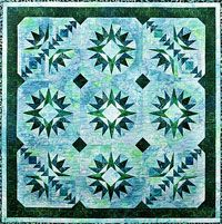 """Sea Star Pattern by Elisa Wilson of Back Porch Designs at KayeWood.com. The colors used in this quilt give it an ocean quality. This quilt also uses the 6"""" Quick Curves template and paper piecing. Use your rotary cutter to make it simple and accurate. Master paper  piecing sheets are included, you will need your preferred paper for making foundation copies. Quilt measures 42"""" x 42"""". http://www.kayewood.com/item/Sea_Star_by_Elisa_s_Backporch/1764 $14.00"""
