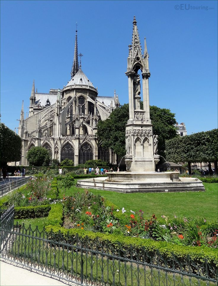 Taken while standing in the Square Jean XXIII square in Paris you can see a great view of the Fountain of the Virgin and the Notre Dame Cathedral in the background as well as some of the well kept gardens.  To see more go to www.eutouring.com/images_square_jean_xxiii.html