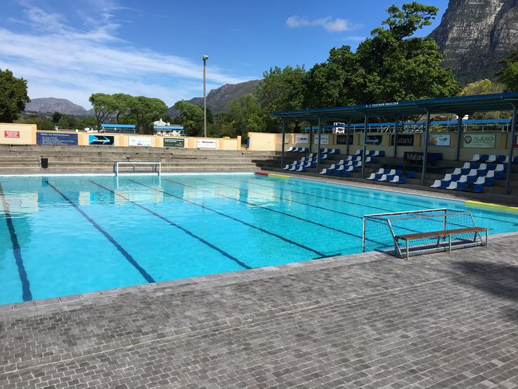 SACS High School pool area paved in our Kent cobble 110x110x50. www.revelstone.co.za
