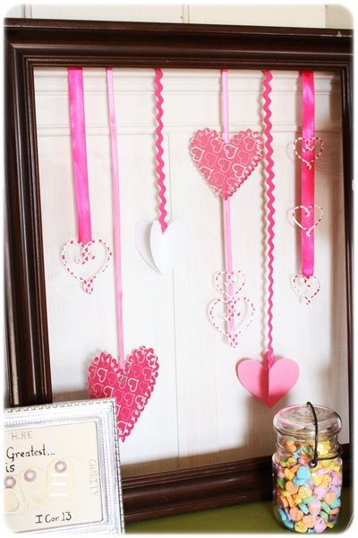 Love this quick decorating idea fo rmy mantel or an empty shelf. Just cut out hearts of various sizes and hang from pretty ribbon in an inexpensive frame