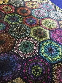 Dreaming of Persia? I have been ever since I began knitting this blanket! Hexagon motifs are grafted together to create a complex web of colorwork, all in eastern inspired motifs.