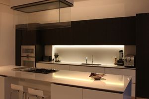 An alternative way of lighting the work surface below cabinets is to use a linear light source such as the LED Contour strip.  This provides a continuous lighting effect which is ideal for today's contemporary kitchens.  Unusual solutions can involve back-lighting a glass splash back which could change colour.