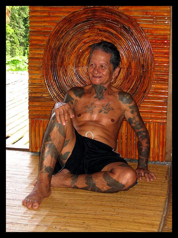a dayak man. Tattoo is not a fashion but part of one's identity