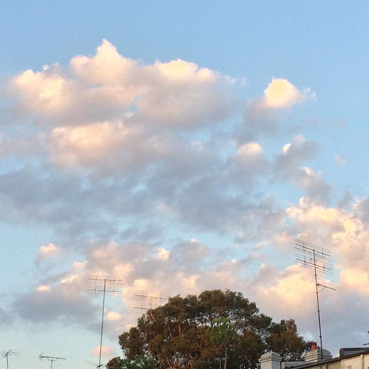 Blue sky and clouds with antenna reaching up to them - #bluesky #clouds #antenna #antennas #Sydney
