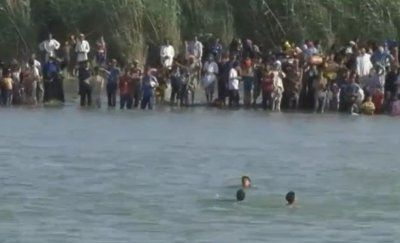 Iraqi families attempt to escape the besieged city of Fallujah by crossing the Euphrates river